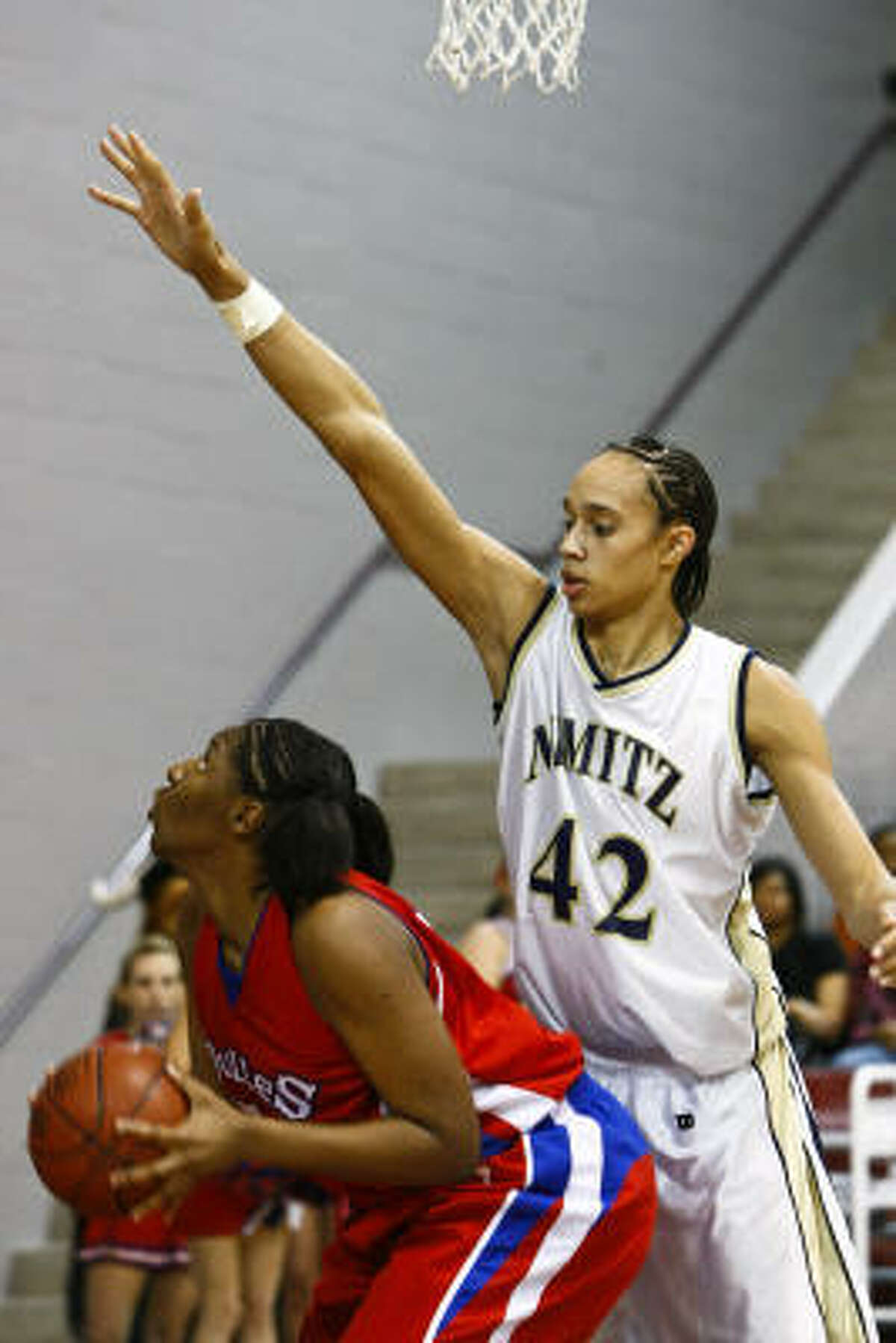 Brittney Griner (42) of Nimitz defends Kelsey Bone (55) of Dulles.