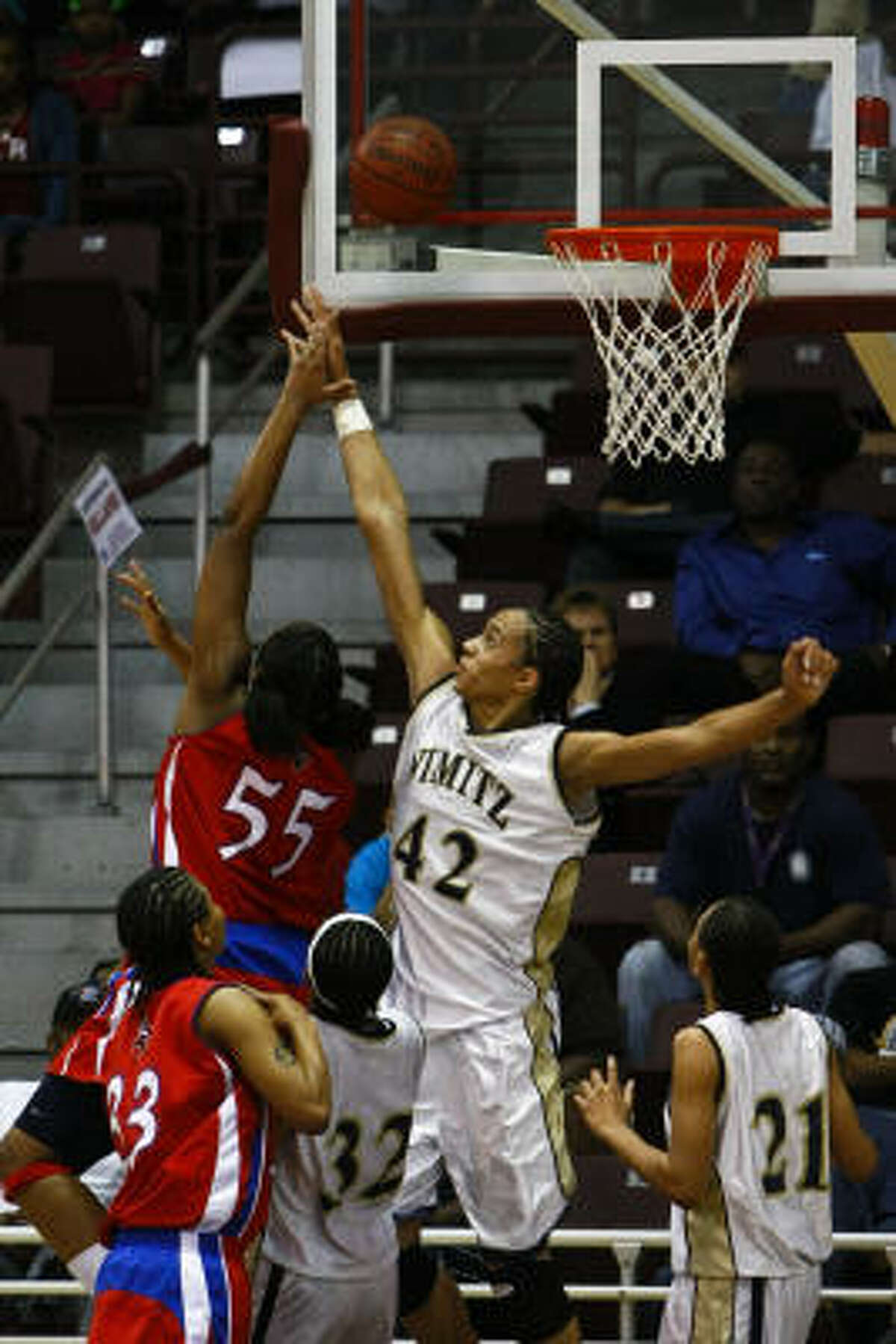 Kelsey Bone (55) of Dulles gets a shot over Brittney Griner (42) of Nimitz.