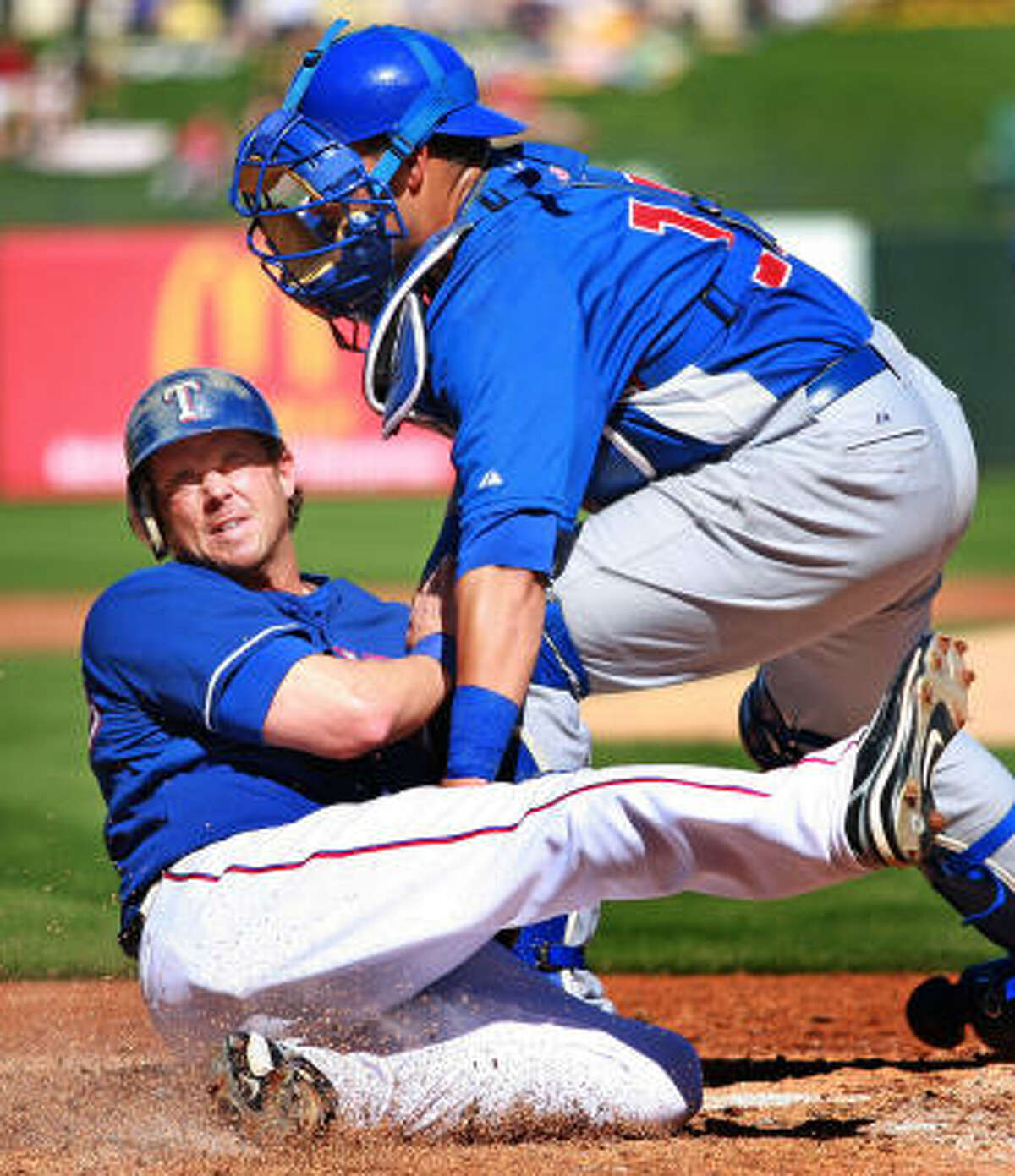 Chicago Cubs catcher Geovany Soto (right) tags out Texas Rangers outfielder Frank Catalanotta in the second inning.