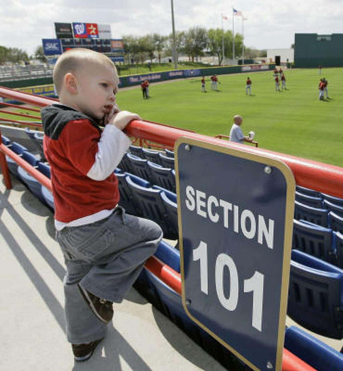 Landon Martin, 2, of Viera, Fla. watches the Astros take batting practice.