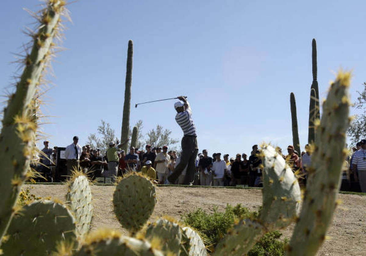 Tiger Woods hits his tee shot on the second hole during his second-round loss to Tim Clark.