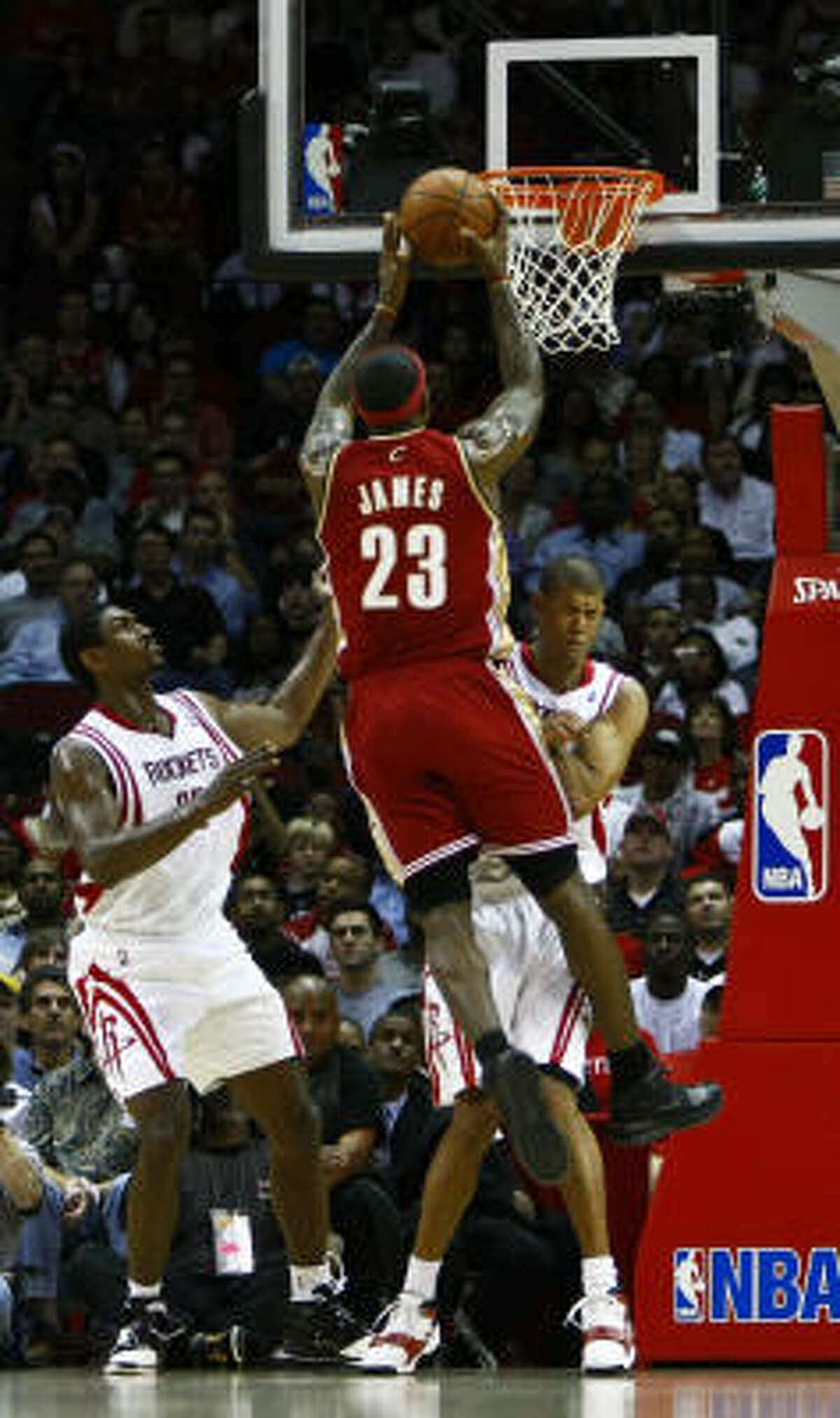 Shane Battier, back, stays planted to draw an offensive foul on LeBron James (23) during the first quarter.