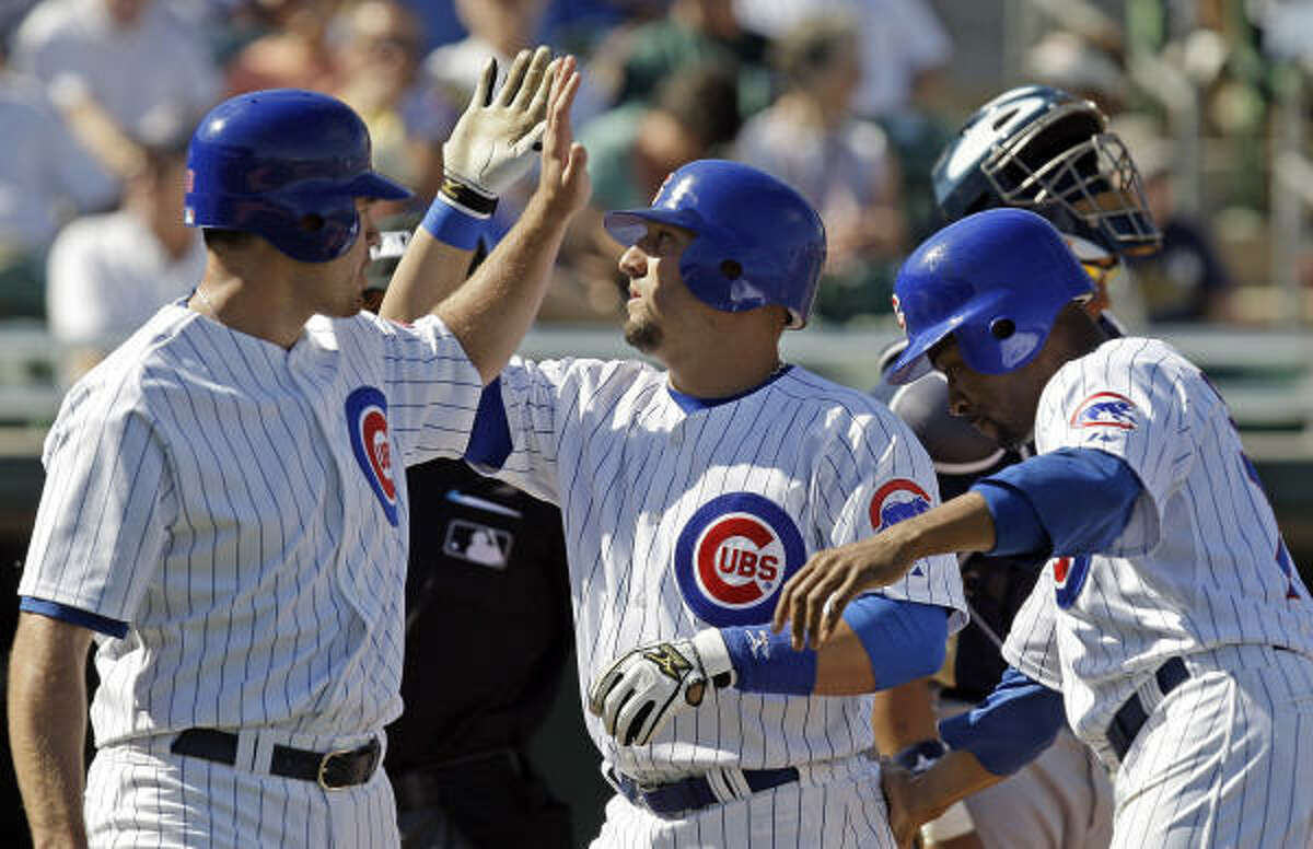 Chicago first baseman Jake Fox, center, hit a three-run home in the Cubs' 7-4 win over the Brewers.