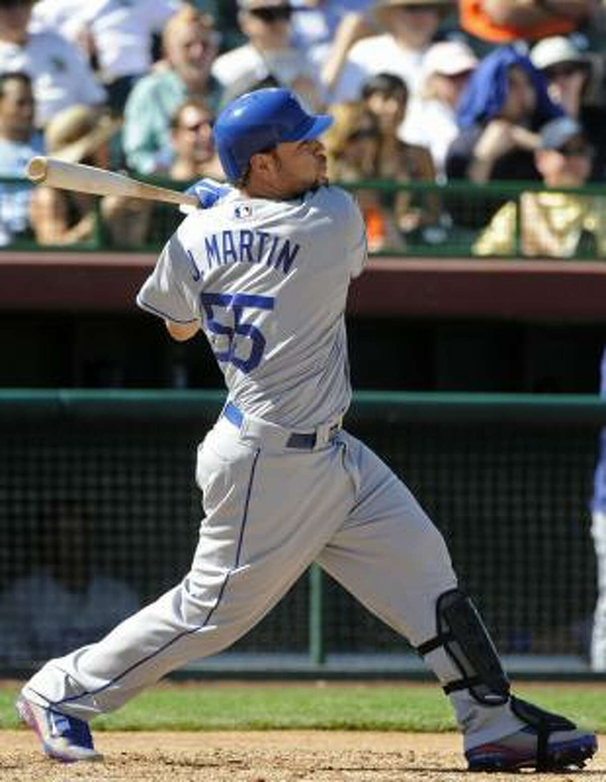 Los Angeles Dodgers' Russell Martin hits a home run and a two-run double in Thursday's 16-7 win over the Giants.
