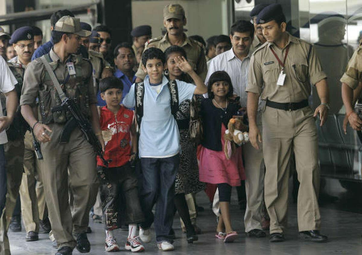 "The child actors of the film ""Slumdog Millionaire"" from left, Ayush Khedekar, Tanay Hemant Chheda, Tanvi Lonkar, and Rubina Ali Qureshi arrive at the international airport in Mumbai Thursday."