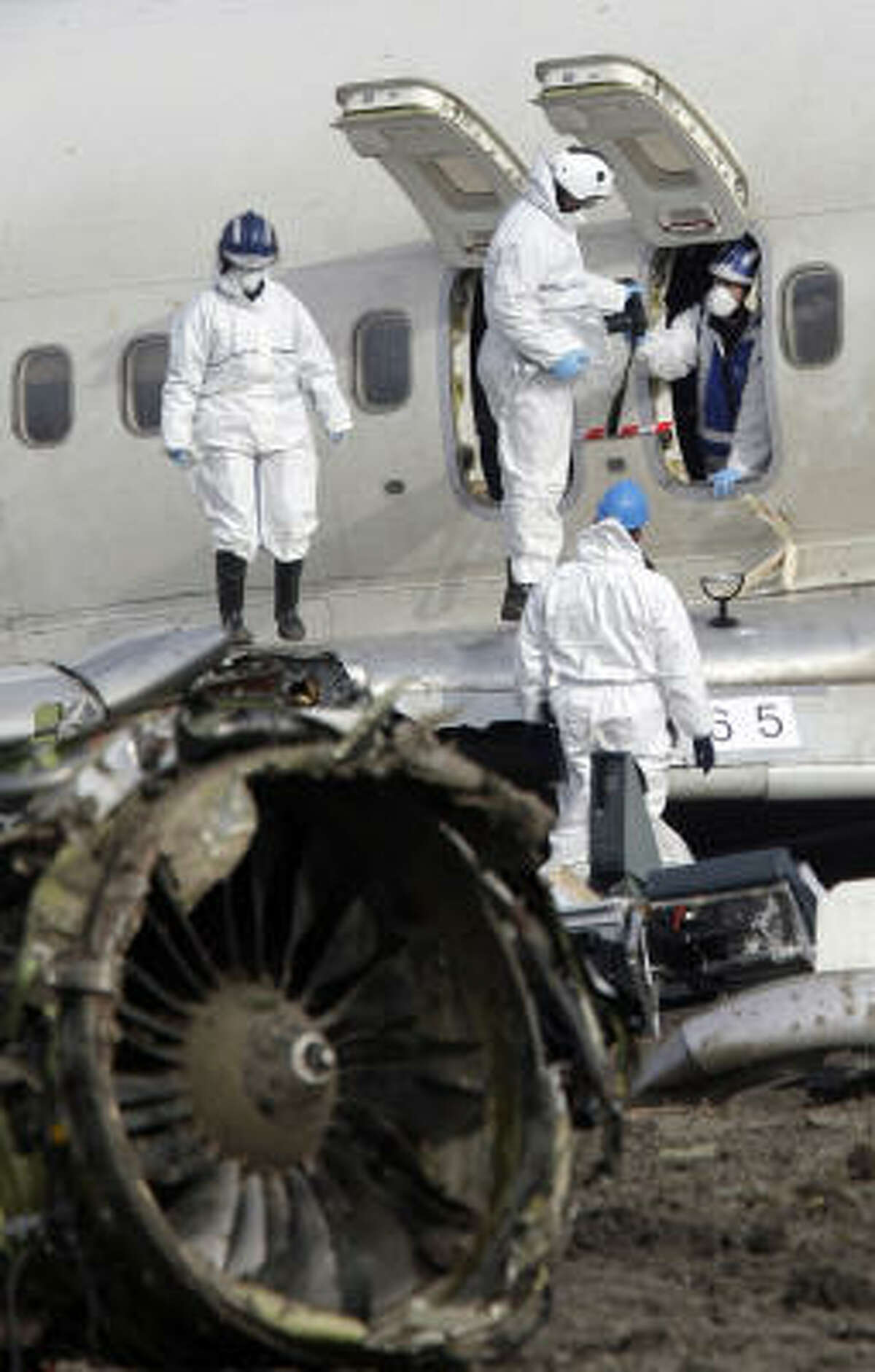 Investigators took detailed photos of the wreckage at Amsterdam's Schiphol Airport Thursday, trying to piece together why the plane lost speed and crashed into a muddy field, killing nine people and injuring 86.