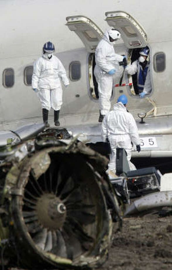 Investigators took detailed photos of the wreckage at Amsterdam's Schiphol Airport Thursday, trying to piece together why the plane lost speed and crashed into a muddy field, killing nine people and injuring 86. Photo: BAS CZERWINSKI, AP