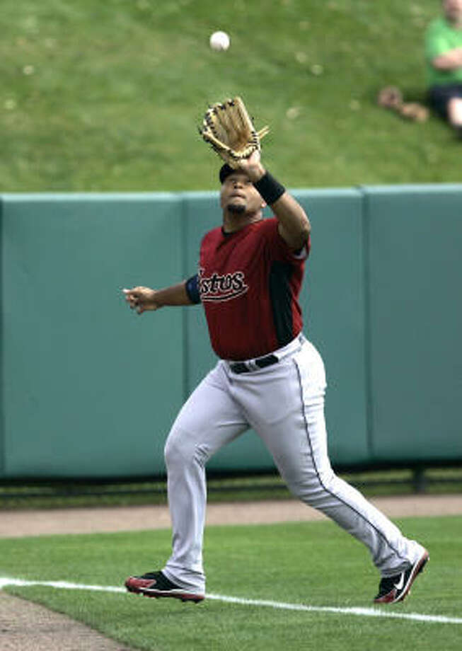 Carlos Lee, in his first spring training game of the year, catches a fly ball in the third inning. Photo: John Raoux, AP