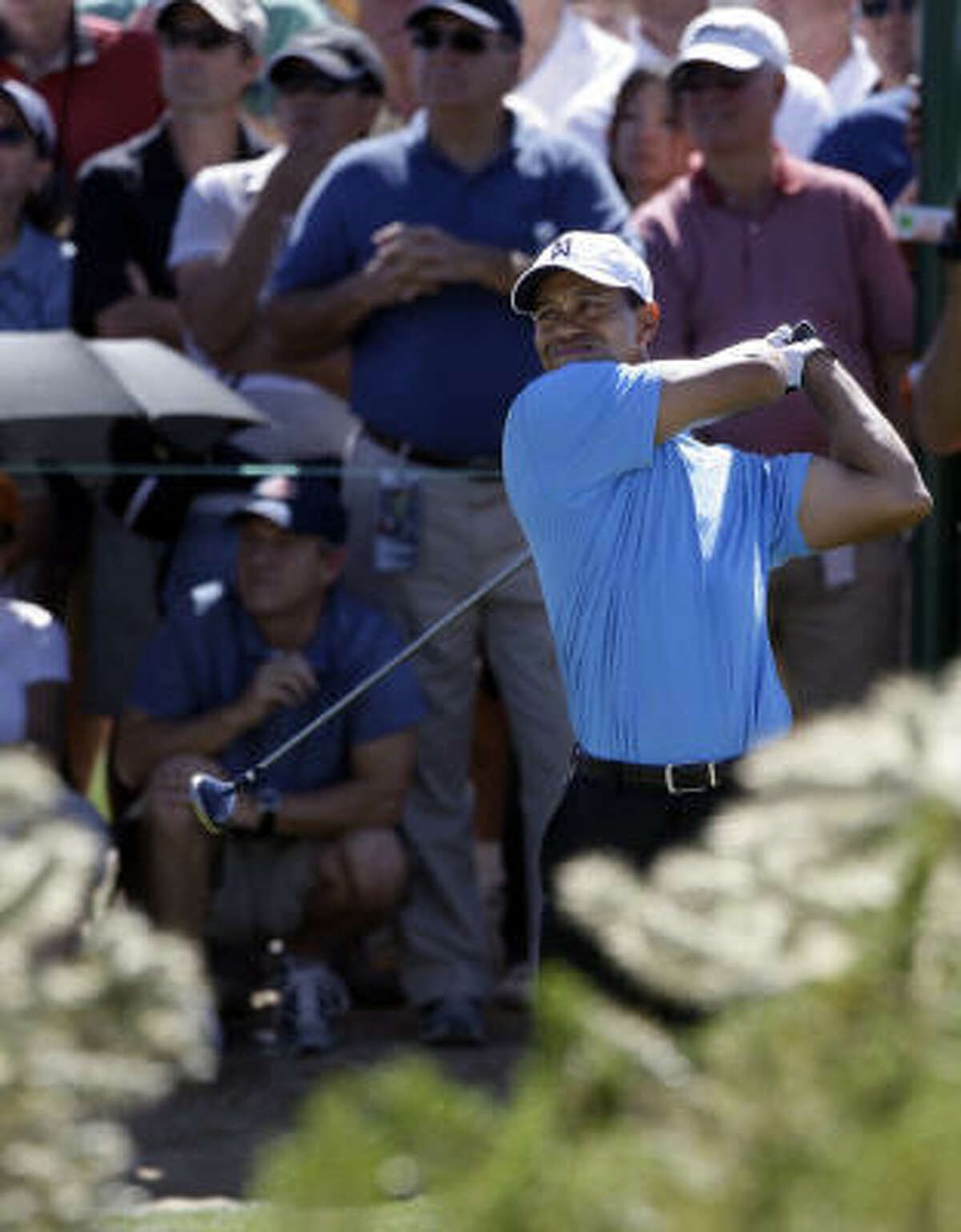 Tiger Woods tees off on the eighth hole, where he regained his 2-up lead over Brendan Jones.