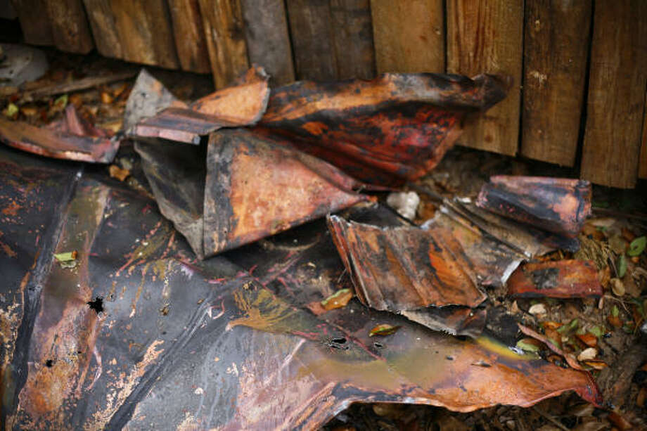 Salvaged copper from the front portico of Dan Phillips' Bone House will be used in the next incarnation of the building which burnt to the ground February 12. Photo: Michael Paulsen, Chronicle