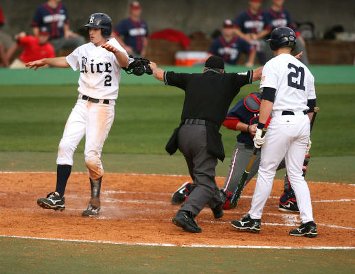 Rice's Jimmy Comerota scores from first.