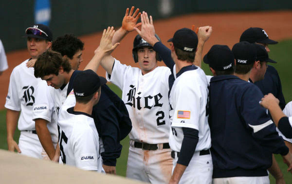 (center) Jimmy Comerota celebrates with his teammates after scoring from first base.