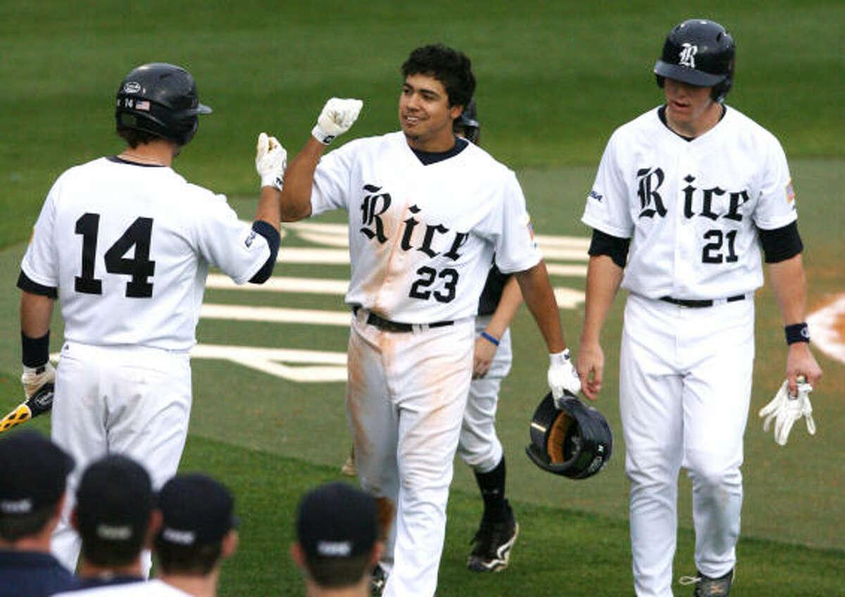 (center) Rice University third basemen Anthony Rendon (23) celebrates his home run in fourth inning.