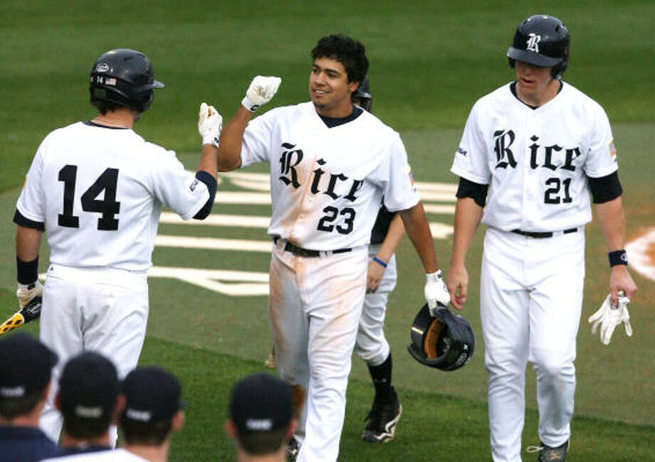 (center) Rice University third basemen Anthony Rendon (23) celebrates his home run in fourth inning. Photo: Billy Smith II, Chronicle