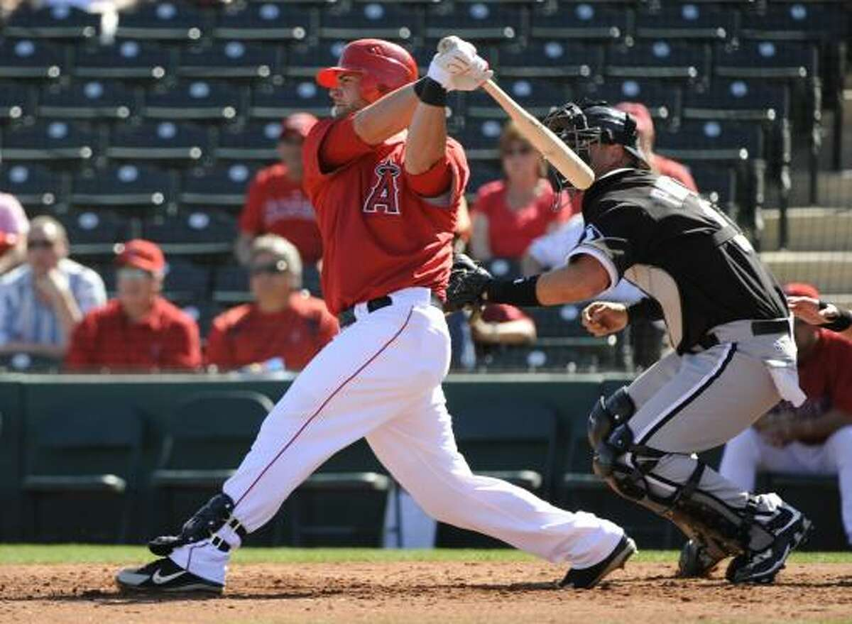 Napoli's two-run double highlighted a three-run third inning and helped the Los Angeles Angels beat the Chicago White Sox 12-3 in the exhibition opener for both teams Wednesday.