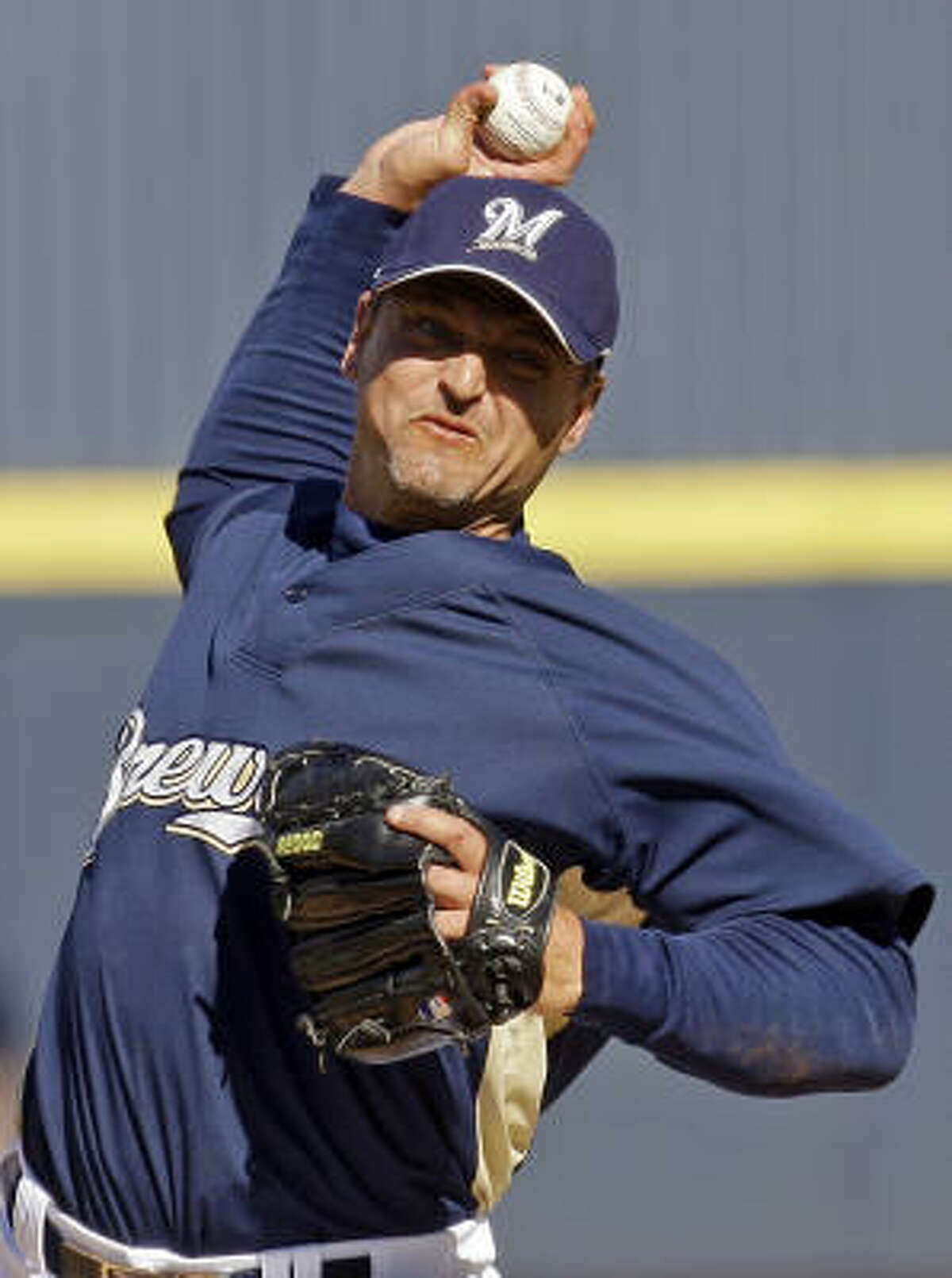 Trevor Hoffman pitched a scoreless seventh inning in his first appearance with Milwaukee, and the Oakland Athletics tied the Brewers 3-3 in 10 innings Wednesday.