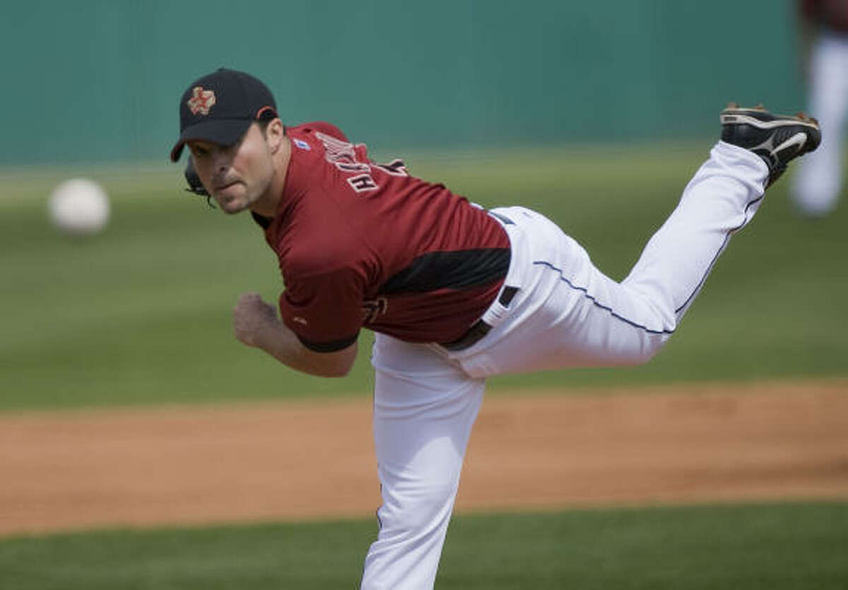 Mike Hampton had early control problems but settled in for two scoreless innings in his Astros return.