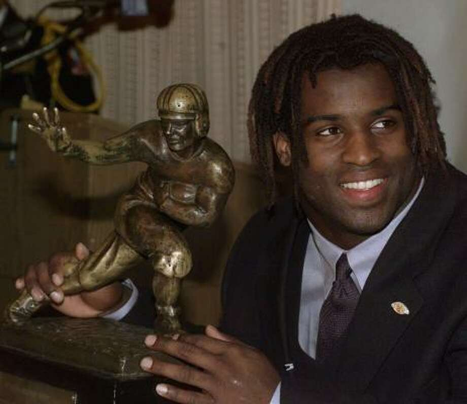 Ricky Williams, No. 34, football (1995-98):  Williams captured a Heisman Trophy. During his four-year career at Texas, Williams rushed for 6,279 yards and 72 TDs. He also was a two-time winner of the Doak Walker Award. Photo: SUZANNE PLUNKETT, AP