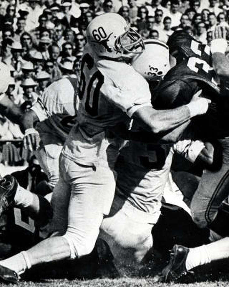 Tommy Nobis, No. 60, football (1963-65):  A two-time All-American, Nobis was a star linebacker on the Longhorns' 1963 national championship team. As a senior, Nobis won the Outland Trophy and Maxwell Award. Photo: University Of Texas