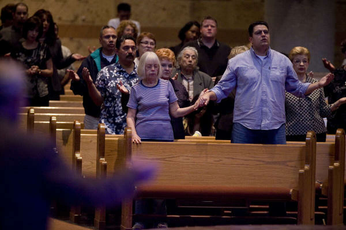 Parishioners pray during Ash Wednesday services at St. Helen Catholic Church in Houston.