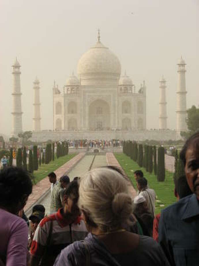 Even in a dust storm, the gardens of the Taj Mahal are packed with people. Photo: Kristina Herrndobler, HOUSTON CHRONICLE