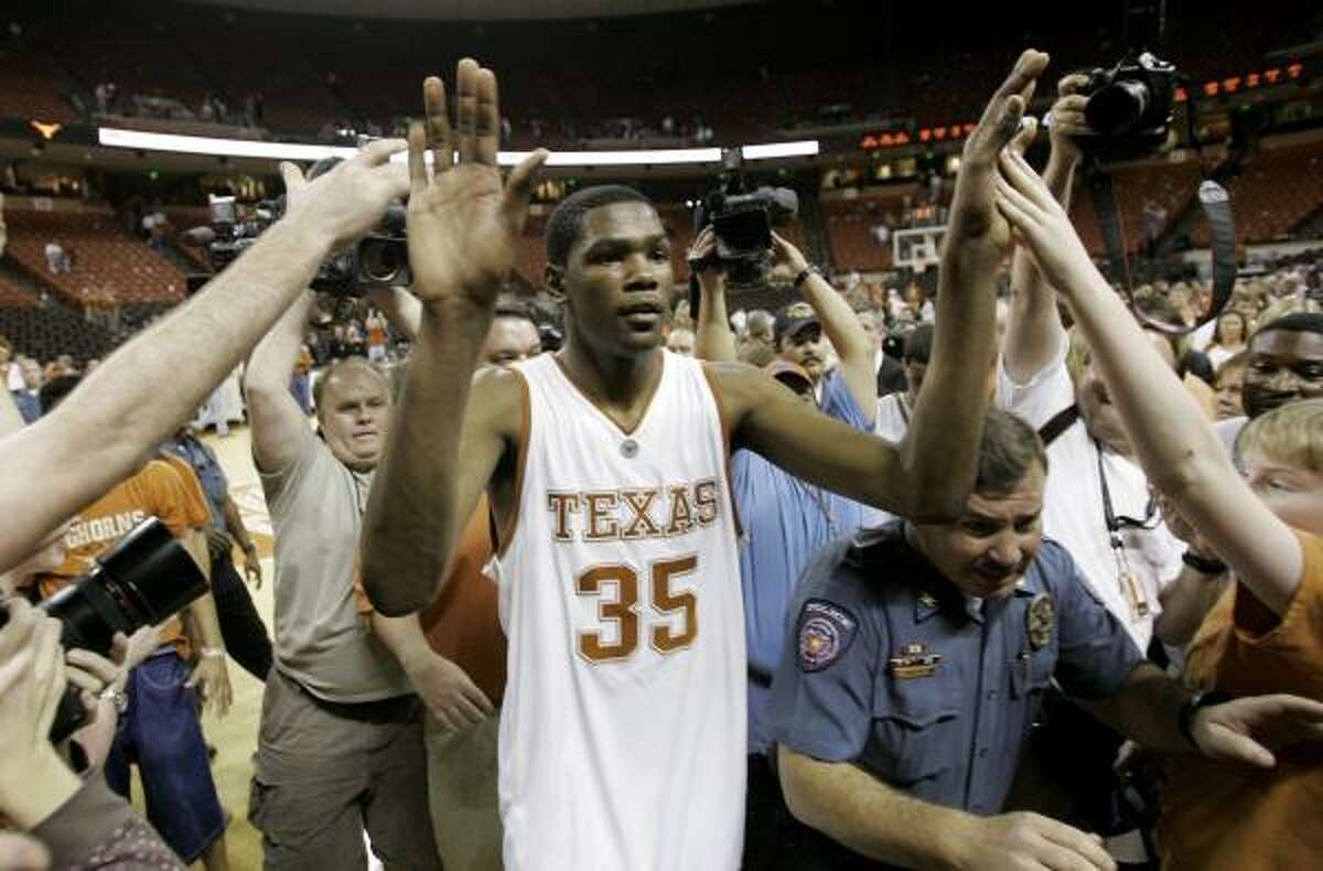 Kevin Durant greets fans after the Longhorns beat Texas A&M 98-96 in double overtime.