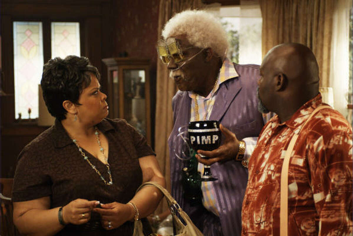Cora (Tamela Mann, left), Uncle Joe (Tyler Perry, center) and Brown (David Mann) star in Tyler Perry's Madea Goes to Jail.