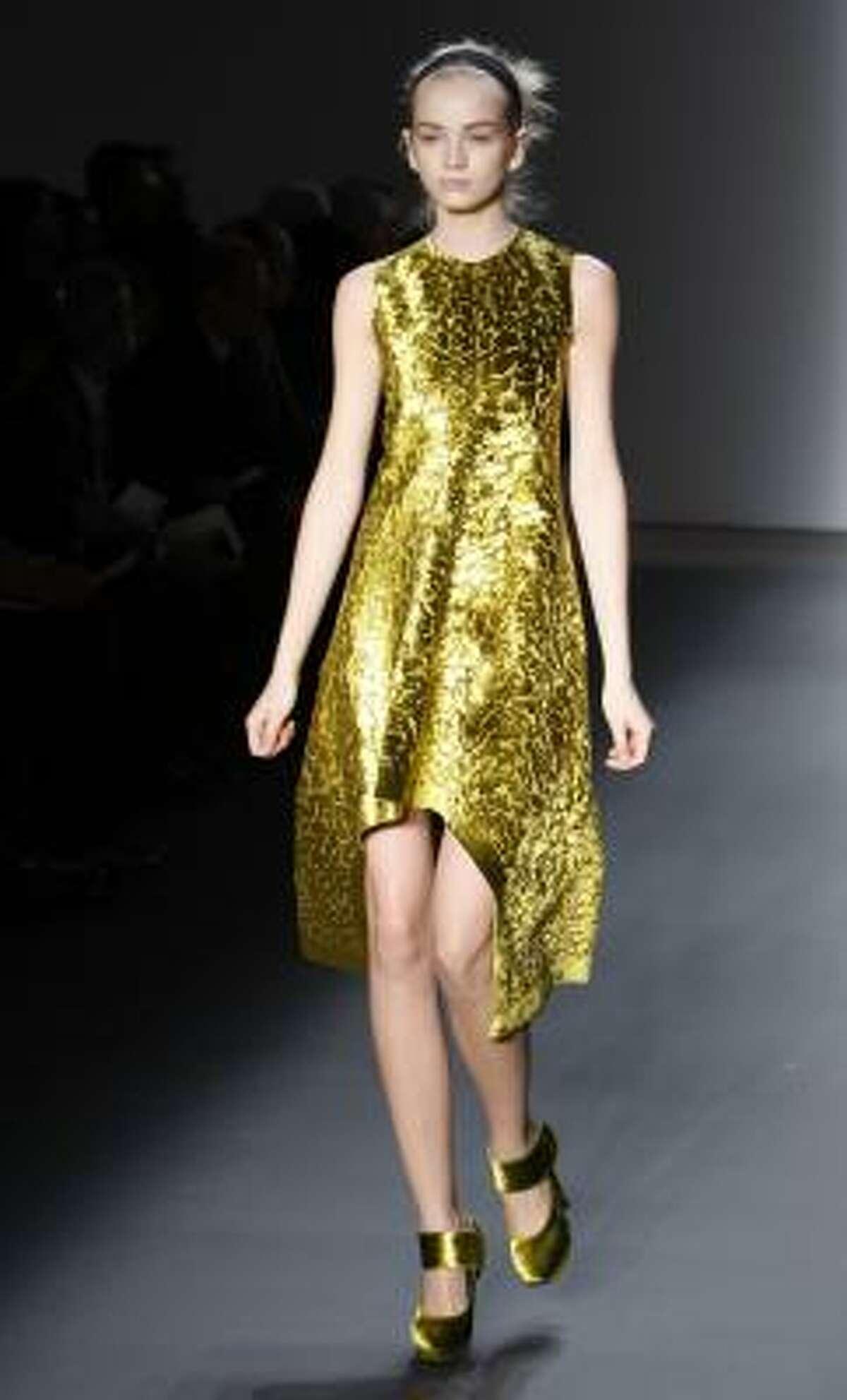 Metallic gold Calvin Klein dress.