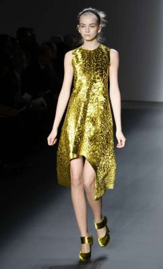 Metallic gold Calvin Klein dress. Photo: Kathy Willens, AP