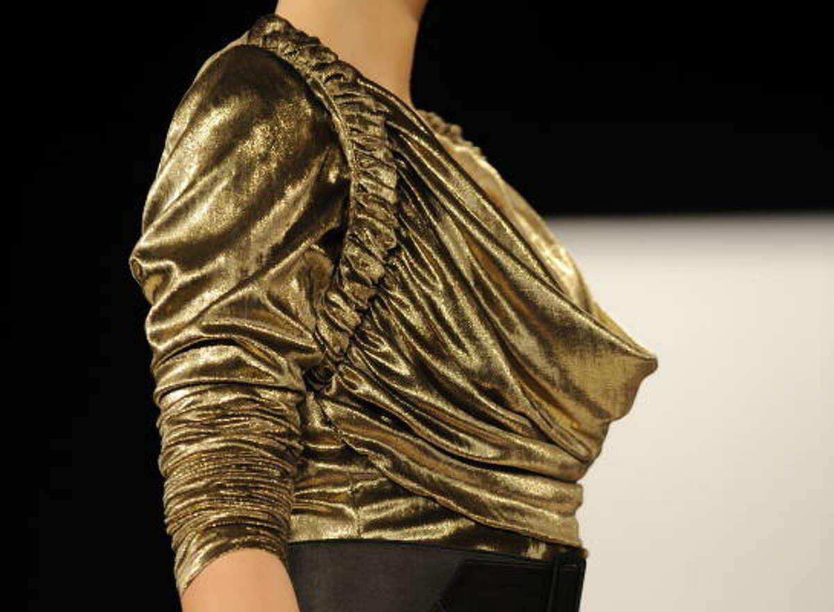 Close-up of Badgley Mischka liquid gold blouse.