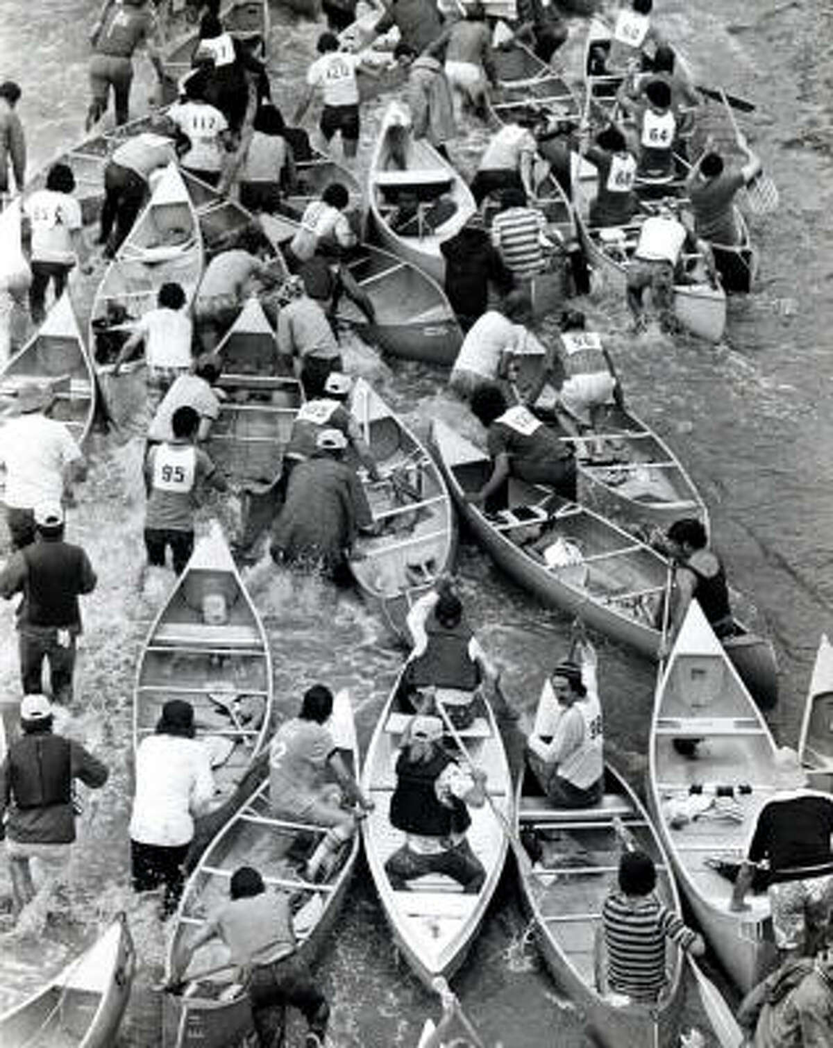 The Reeking Regatta canoe race gets under way at San Felipe bridge and Buffalo Bayou in 1977.