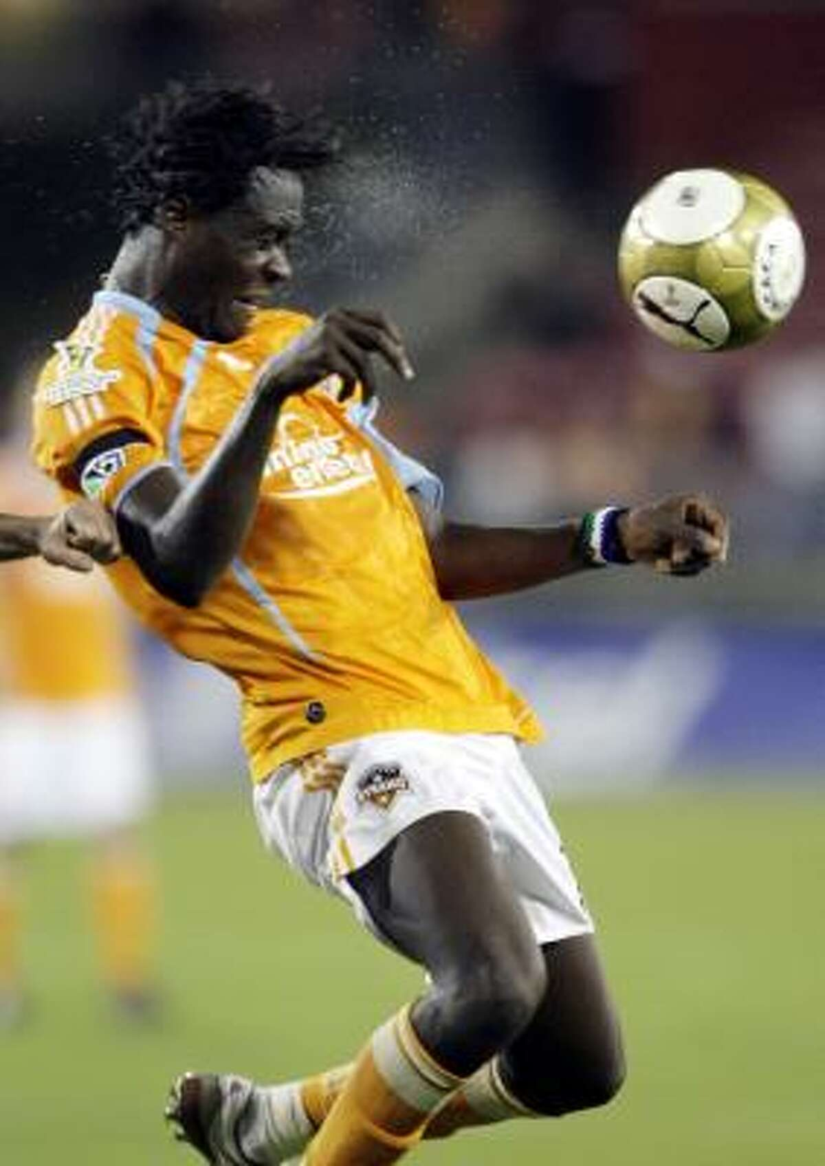 Dynamo forward Kei Kamara heads the ball away during the first half against Atlante.