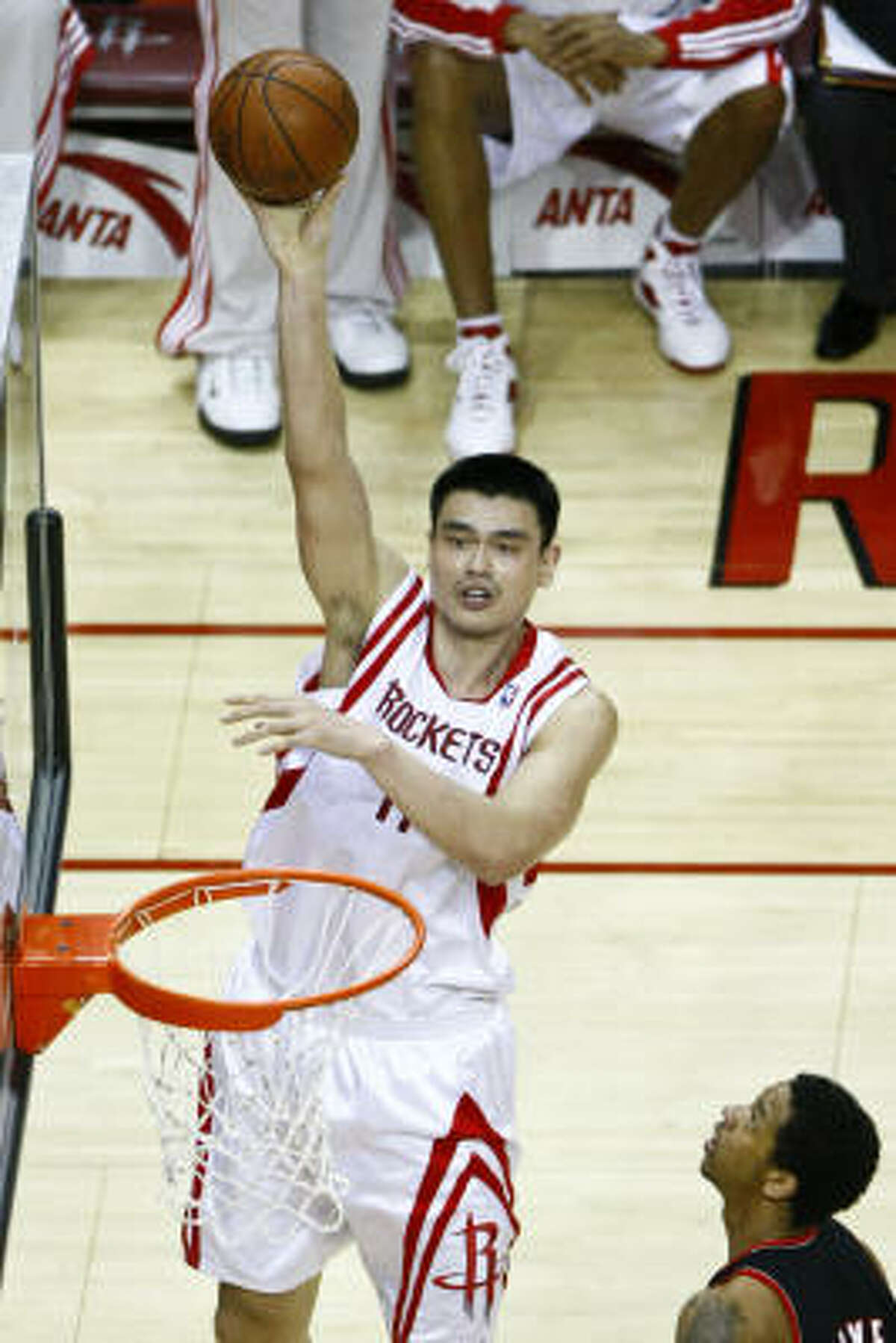 Yao Ming (11) puts up a shot during the first quarter.