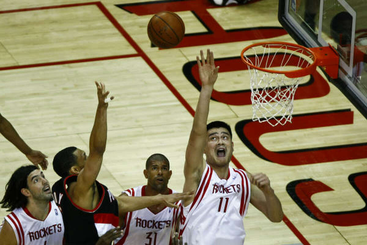 Yao Ming (11) goes for a block during the first quarter.