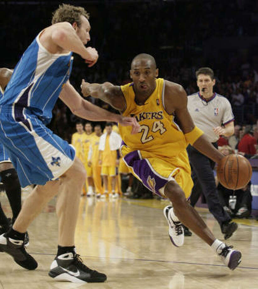 1 - LOS ANGELES LAKERS - (Last wk: 1) - 46-10 - Kobe and his posse are 4-0 since the All-Star break and looking like they don't even need Andrew Bynum. Actually, it's Chris Mihm they didn't need, shipping him to Memphis. They're watching Bynum's progress from his most recent knee injury to know if they'll really be the favorites heading into the playoffs. Photo: Francis Specker, AP