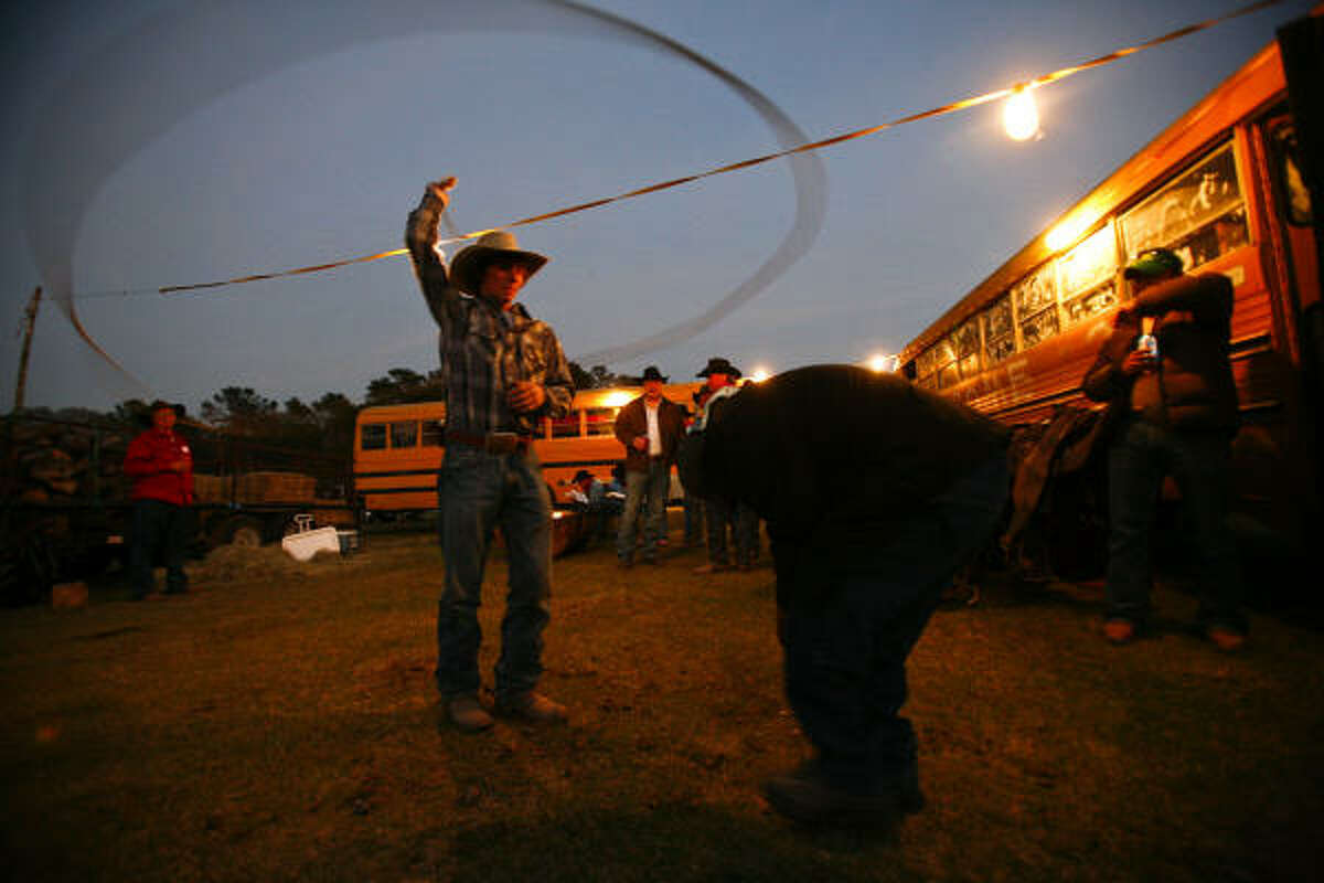Hunter Harrington, 17, practices his roping skills after arriving at a camp site near Magnolia with the 240 riders who had traveled 18 miles of the Sam Houston Trail Ride by Monday.
