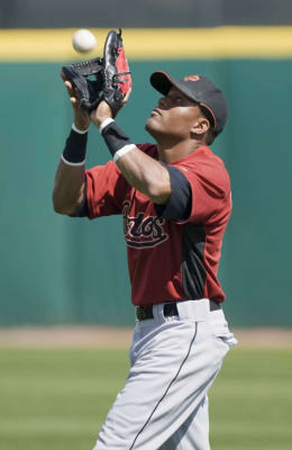 Yordany Ramirez catches a fly ball in an intra-squad game.