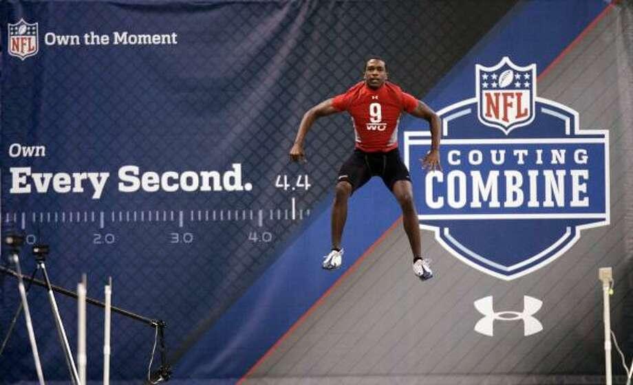 Rice receiver Jarett Dillard loosens up before running the 40-yard dash. Photo: Michael Conroy, AP