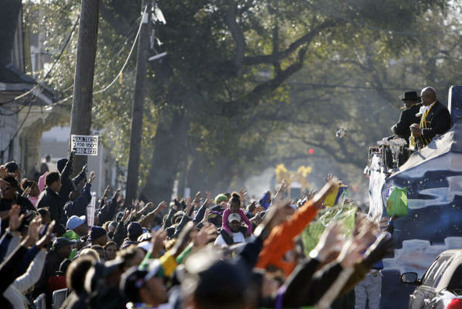 Crowds fill Jackson Avenue during the Zulu parade on Mardi Gras in New Orleans Tuesday, Feb. 24. Carnival revelers were greeted with clear and cool weather for Mardi Gras. Photo: Alex Brandon, AP