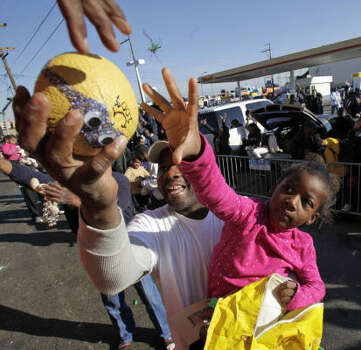 Tayana Otis, 5, from New Orleans, reaches for a famous Zulu coconut during the Zulu parade on Mardi Gras in New Orleans on Tuesday. Photo: Alex Brandon, AP