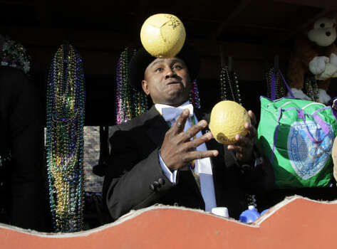 A rider juggles Zulu coconuts on his float during the Zulu parade on Mardi Gras in New Orleans Tuesday. Photo: Alex Brandon, AP