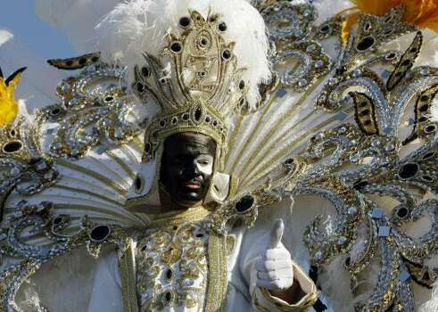 King Zulu Tyronne Mathieu gives a thumbs up before his ride in the Zulu parade on Mardi Gras in New Orleans Tuesday. Photo: Alex Brandon, AP