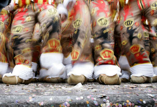 Traditional 'Gilles' dance in their colorful costumes and wooden clogs, during the Mardi Gras festival in Binche, Belgium on Tuesday. Photo: Virginia Mayo, AP