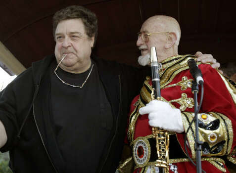Pete Fountain right, talks with friend actor John Goodman before he and his Half Fast Walking Club march onto St. Charles Avenue in the Garden District of New Orleans Tuesday. Photo: Alex Brandon, AP