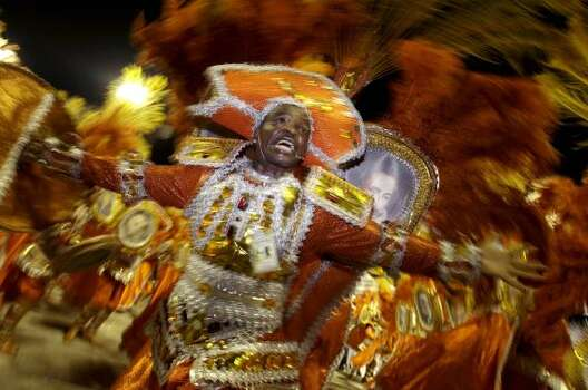 Dancers perform during the Mocidade samba school parade at the Sambodrome in Rio de Janeiro Monday. Photo: Natacha Pisarenko, AP