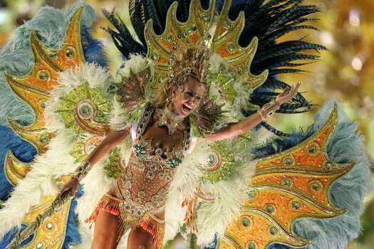 A dancer of Imperio Serrano samba school performs in Rio de Janeiro Sunday. Brazil's Carnival added a mature twist early Tuesday by giving two women in their 40s a chance to dance nearly nude at the head of their samba parades. Photo: Ricardo Moraes, AP