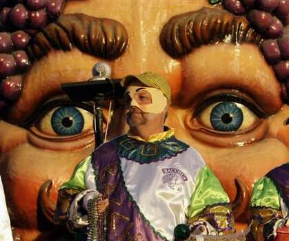 A rider looks to throw his beads during the Krewe of Bacchus parade in the Uptown area of New Orleans Sunday, Feb. 22, 2009. Photo: Alex Brandon, AP