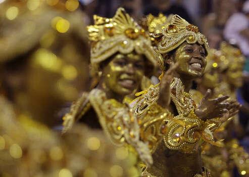 Dancers perform during the Vila Isabel samba school parade at the Sambodrome in Rio de Janeiro Monday. Photo: Natacha Pisarenko, AP