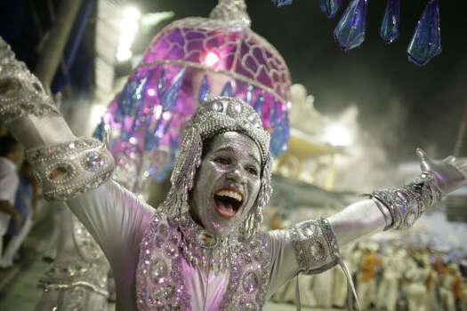 A dancer performs during the Vila Isabel samba school carnival parade at the Sambodrome in Rio de Janeiro Monday. Photo: Natacha Pisarenko, AP