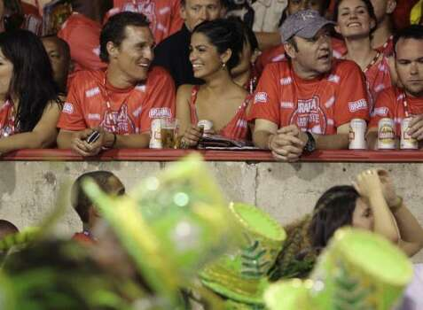 Actor Kevin Spacey, second right, looks at the carnival parade at the Sambodrome in Rio de Janeiro, Monday. Second left is actor Matthew Mc Conaughey and his girlfriend Camila Alves. Photo: Natacha Pisarenko, AP